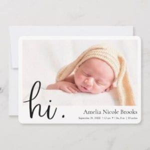 simple modern horizontal photo birth announcement for boy or girl with white borders and hi in black script