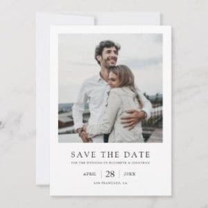 simple modern black and white wedding save the date card with photo and borders and a vintage polaroid look