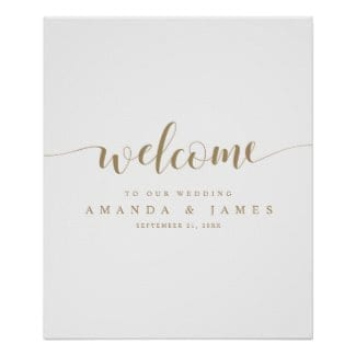 simple modern minimalist wedding welcome sign with text in gold and a whimsical script on a white base