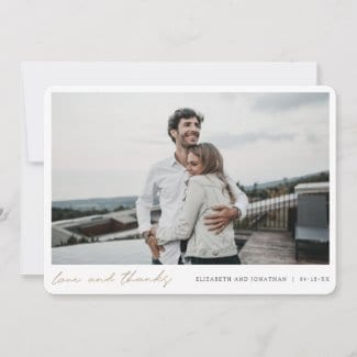 simple modern horizontal wedding thank you card with love and thanks in gold script below photo