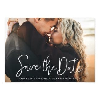 simple, modern horizontal wedding save the date magnet card with white typography and full photo
