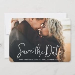 horizpntal wedding save the date card with full photo and modern white script