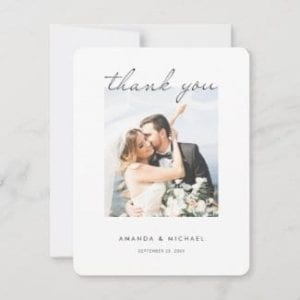 simple modern wedding thank you card with photo and white borders and black script