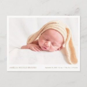 Simple birth announcement postcard with photo and gold text in horizontal format.