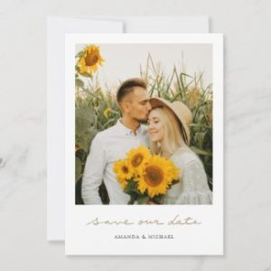 Simple photo save the date cards with gold handwriting.