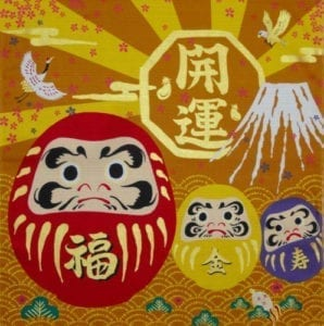 red and gold purple daruma doll